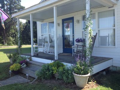 Photo for Cheerful Waterfront Cottage With Perfect Porch For Viewing