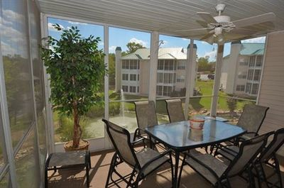 Enjoy the ceiling fan with dinner on the screened porch with a lovely view of the water feature and park.