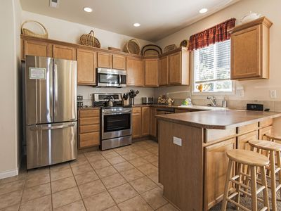 Photo for Spacious 4 Bedroom Home with Fenced Yard, Hot Tub & Close to Golf Courses