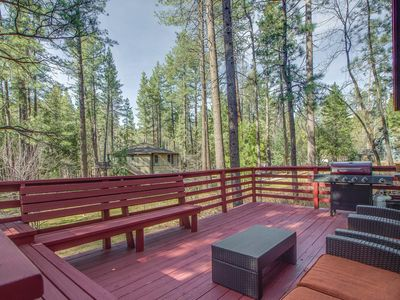 Photo for Charming cabin w/ a private hot tub & deck in a wooded setting - two dogs OK!