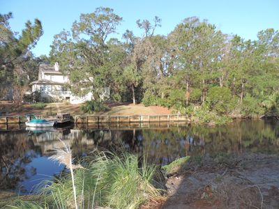 Photo for Beautiful lagoon views, new living room furniture, steps from the beach!