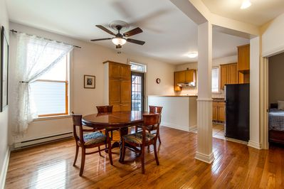 LARGE OPEN DINING ROOM TO THE FULL EQUIPPED KITCHEN