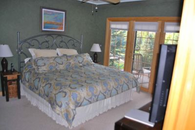 First floor MBR has fireplace and deck. King Bed. HDTV.
