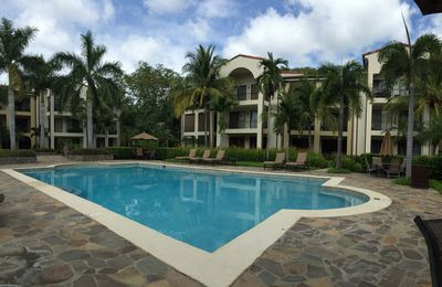 This is our condo building with balcony overlooking this pool