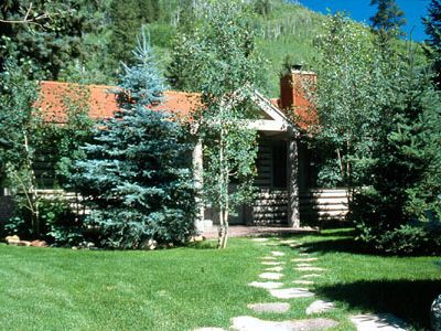 Photo for Cozy Log Cabin w/Hot Tub on Redstone Blvd, beautifully landscaped for privacy.