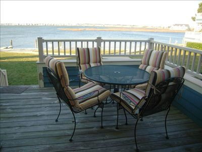 Deck overlooking the backyard and boat slip on the bay. Stunning sunset views!