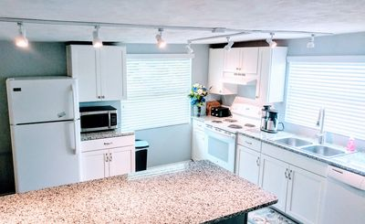 Kitchen with coffee makers and small appliances. Complimentary coffee.