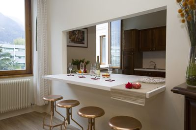 The living room with a breakfast bar