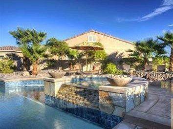 Our private backyard pool and gorgeous spa/waterfall is like a desert oasis!