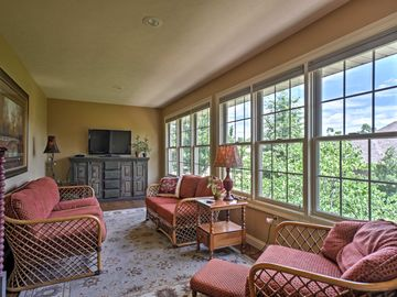 This sunny 4-bedroom, 3-bath vacation rental home accommodates 8 guests.