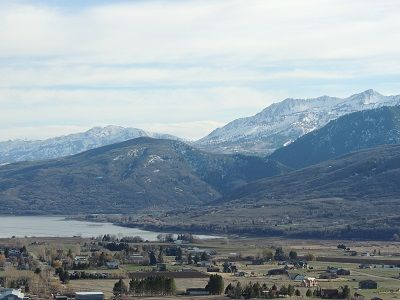 Spectacular valley views.Snowbasin in distance. Wolf Mountain runs lit at night.