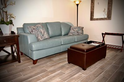 Living area with real leather couch that opens into a  queen size sleeper.