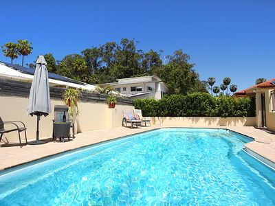 Photo for 4 bedroom spacious home 5 minutes flat walk to the beach... small dog friendly