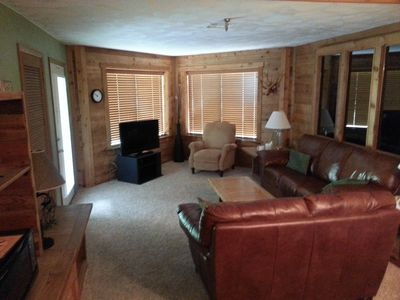 Living room with comfortable leather sofa and love seat