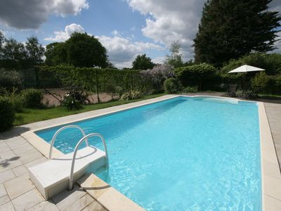 Photo for Charming farmhouse with pool and tennis court.