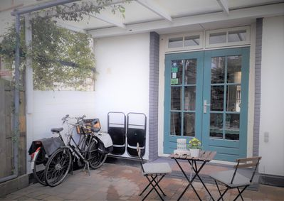 A private entrance to a garden courtyard with 2 bicycles for guests to use FREE