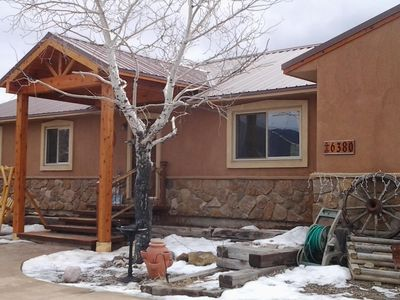 Mountain style covered front entry