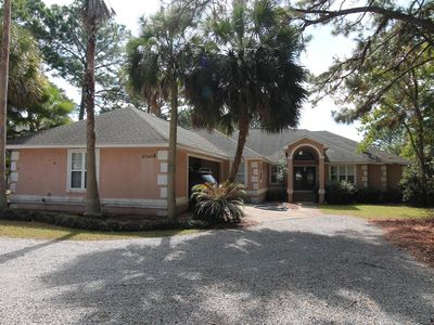 Photo for 5 Bedroom Waterfront Home with Pool and Boat Dock
