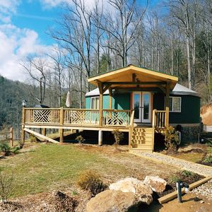 Photo for Glamping at its finest - riverfront yurt, 30-minutes west of Asheville