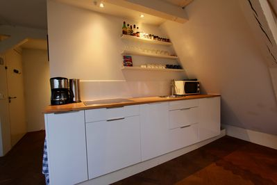 Kitchen with spices, coffee and tea available.