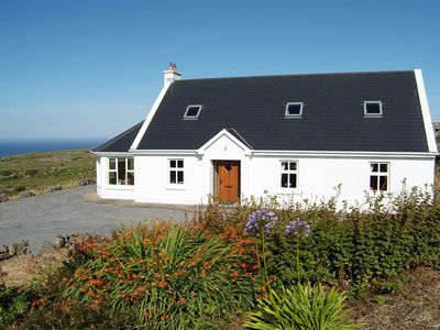 Photo for Cosy Family Cottage. Spectacular views of the Atlantic Ocean and Cliffs of Moher