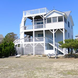 Side view of the house with multiple decks including a rooftop deck