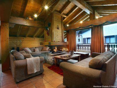 Photo for Wooden chalet with jacuzzi and cinema room 150m from the slopes.