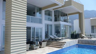 Front view of the exclusive villa with pool area