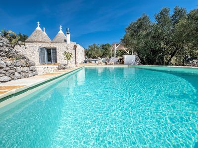 Photo for A stunning large Trullo country House with Heated pool and panoramic view