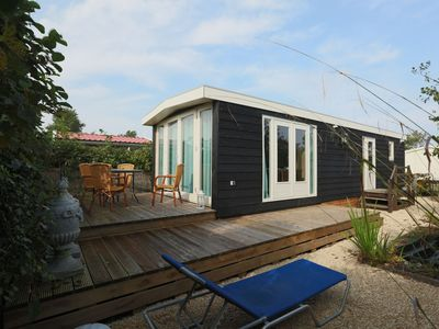 Photo for Comfortable chalet in a holiday park, directly situated by the Waddenzee.