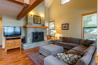 Living room with wood burning fireplace and supplied logs