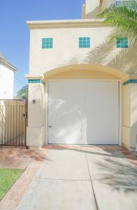 Gated private front entrance with intercom and off street pkg space in driveway