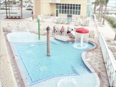 View of kiddie pool and indoor / outdoor pool