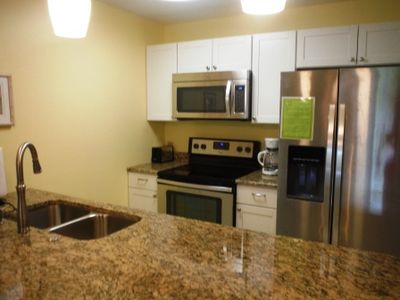 Newly renovated kitchen has granite counters, all new appliances & cabinets.