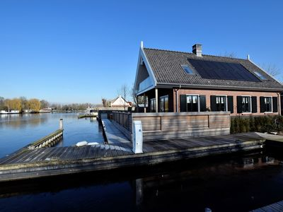 Photo for Luxurious villa with private jetty, directly on the Kagerplassen.