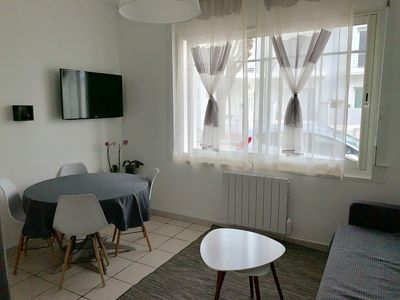 Photo for Beautiful bright downtown apartment in a quiet street with shops
