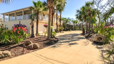 Photo for Oasis by the Sea Beach front community luxurious pool home with Waterfall Sleeps 10