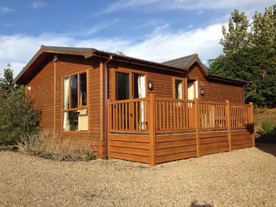 Photo for Charming pet-friendly Lodge with river views, ideal for couples and families