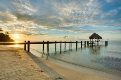 Sunrise over large 150 foot per with palapa and swim deck