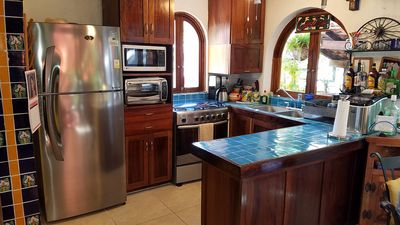 Well equipped kitchen area, huge assortment of dishware and cooking utensils