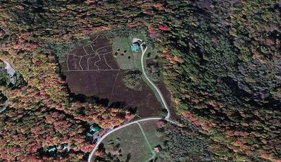 Photo for Private, 6 flat open acres at the peak of the ridge, next to Snowshoe Resort