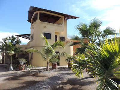 Lovely Casa de Perla with many palm trees in the yard, coco, royal & fan palms