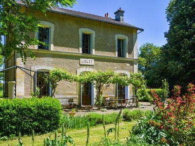 Photo for Former train station with private heated swimming pool and fantastic garden!