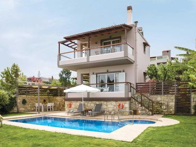 Photo for Villa with views over the 'Golden Coast' - mature gardens surround the veranda & pool
