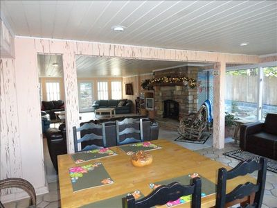 entry to great room & game table, overlooking lake! gas stone fireplace.