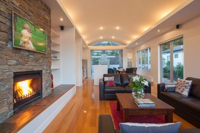 Open log fireplace and comfortable living area with SKY TV channels