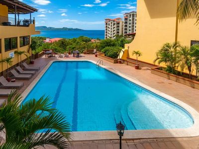 Photo for Spacious 3 Bedroom condo overlooking greenery and blue water of Playa Flamingo