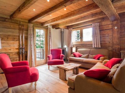 Photo for Surface area : about 146 m². View mountain and mountain. Living room with settee, fireplace