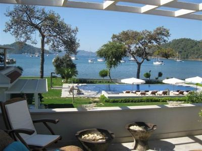 Photo for Rental Luxury Apartment in Gocek With Marina View. The apartment has two spacious double bedrooms 2 bathrooms (1 with a jacuzzi), 2 terraces, communal swimming pool, GYM, 24/7 security service and more..