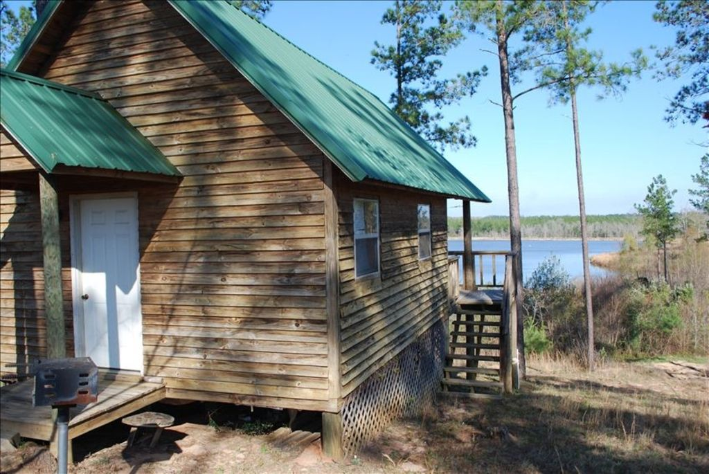 Secluded cabin overlooking private 50 acre bass fishing for Fish lake cabin